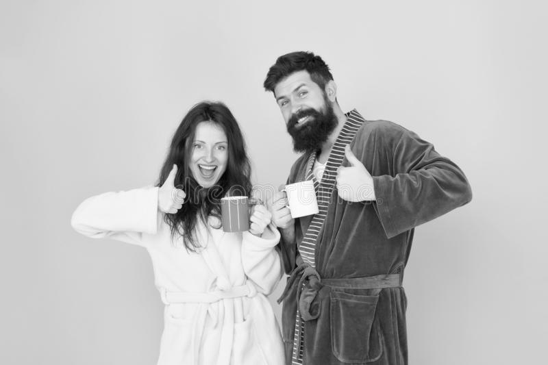 Perfect weekend. good morning. morning couple drink coffee. bearded man and girl coffee cup. they feel rested. family stock photos