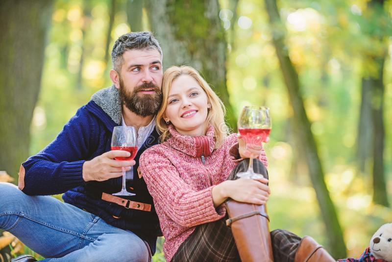 This is perfect wine. Family picnic. Valentines day. couple in love relax in autumn forest. camping and hiking. cheers. Happy women and bearded men drink wine royalty free stock photo