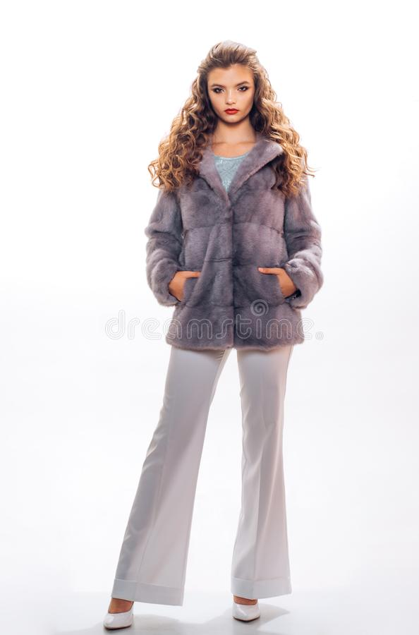 Perfect for winter cold. Fashion model wear luxurious fur. Young woman wear elegant winter coat. Pretty woman in. Fashionable fur coat. Winter fashion trends royalty free stock photo