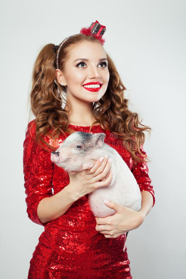 Perfect woman with makeup holding mini pig, fashion portrait royalty free stock photos