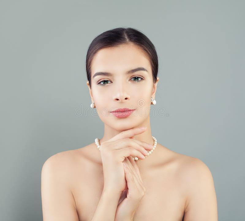 Perfect woman model with healthy skin in pearls necklace and earrings royalty free stock images
