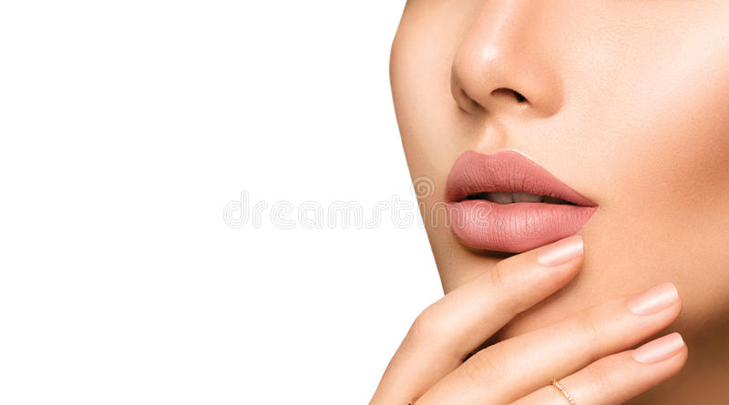 Perfect woman's lips with fashion natural beige matte lipstick stock image