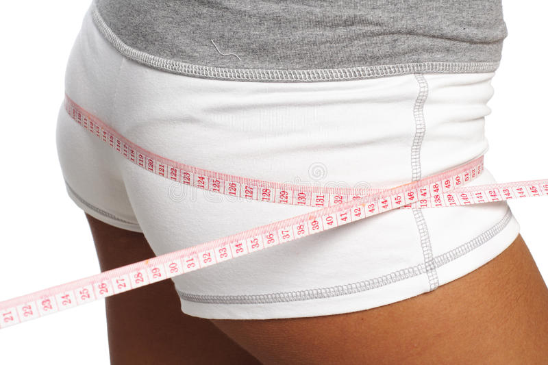 Perfect womans measure by metre-stick royalty free stock photography