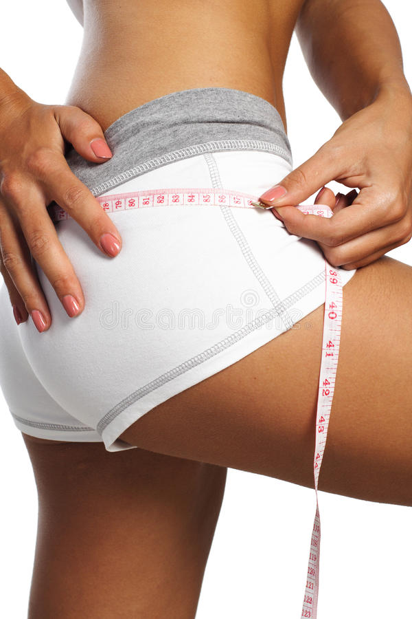Perfect womans measure by metre-stick stock photo