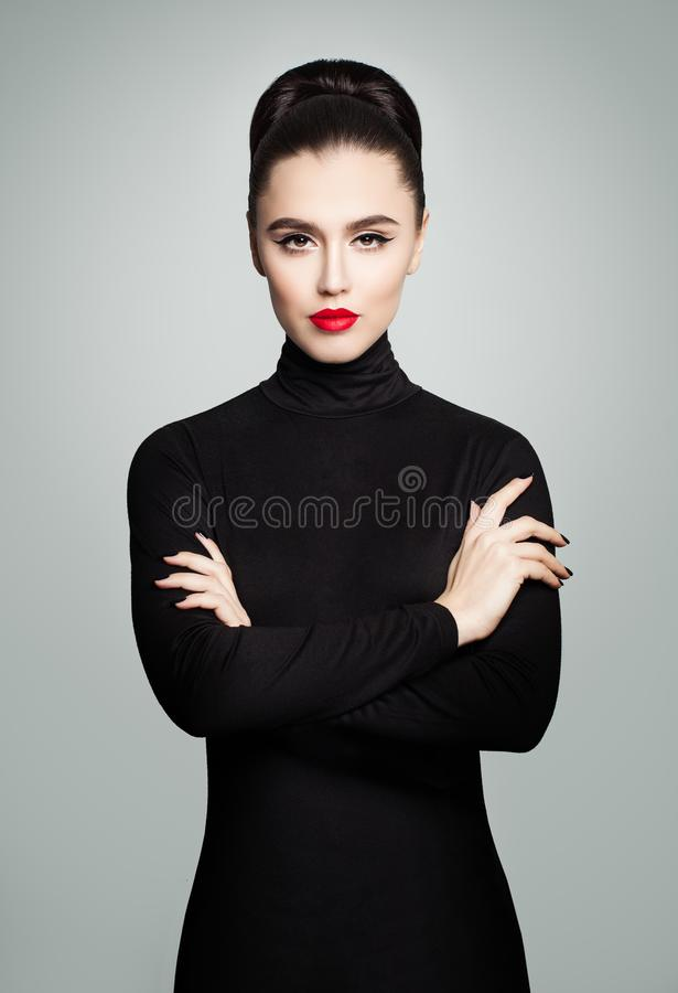 Perfect Young Model Woman wearing Black Roll Neck Dress royalty free stock photo