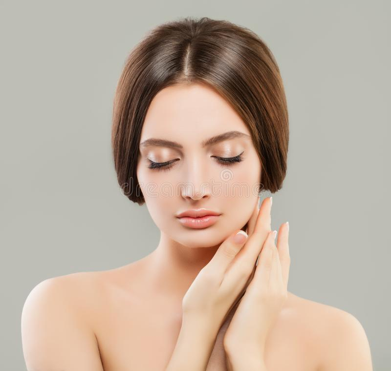 Perfect young woman with clear skin portrait. Skincare and facial treatment concept royalty free stock photo