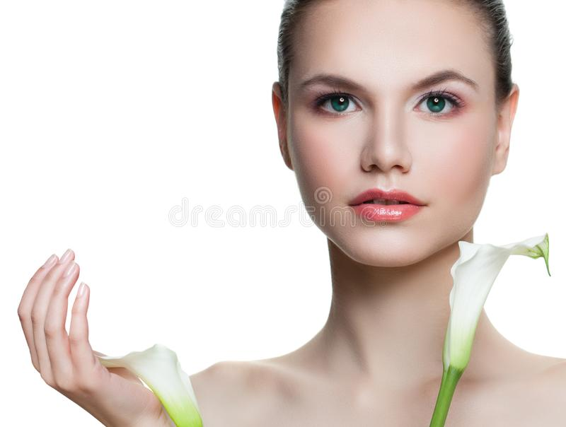 Perfect young woman holding flowers isolated on white background. Beautiful female face with healthy skin royalty free stock photo