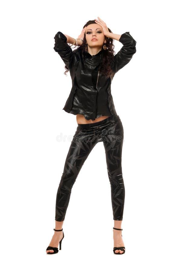 Perfecte jonge brunette in zwarte kleren. Geïsoleerd royalty-vrije stock foto