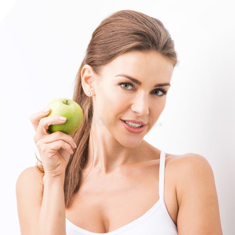 Perfecte vrouw met appel royalty-vrije stock foto