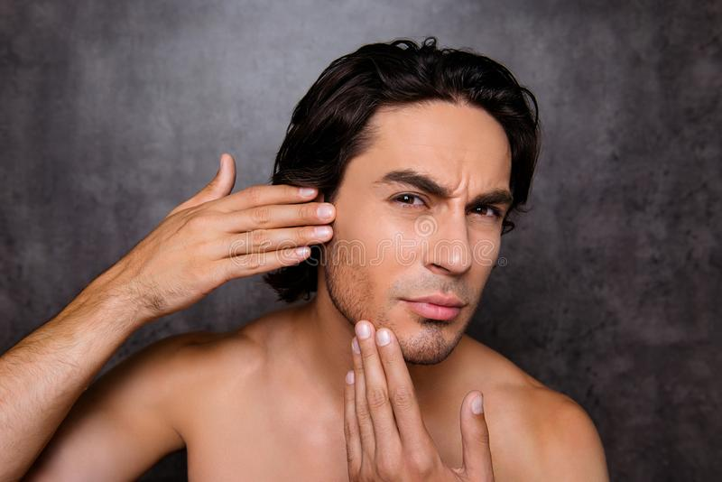 Perfection is a hard work even for men. Pampering, aging, acne,. Pimple, wrinkles, clear and clean, oily, dry skin concept. Cose up cropped photo of worried guy royalty free stock photos