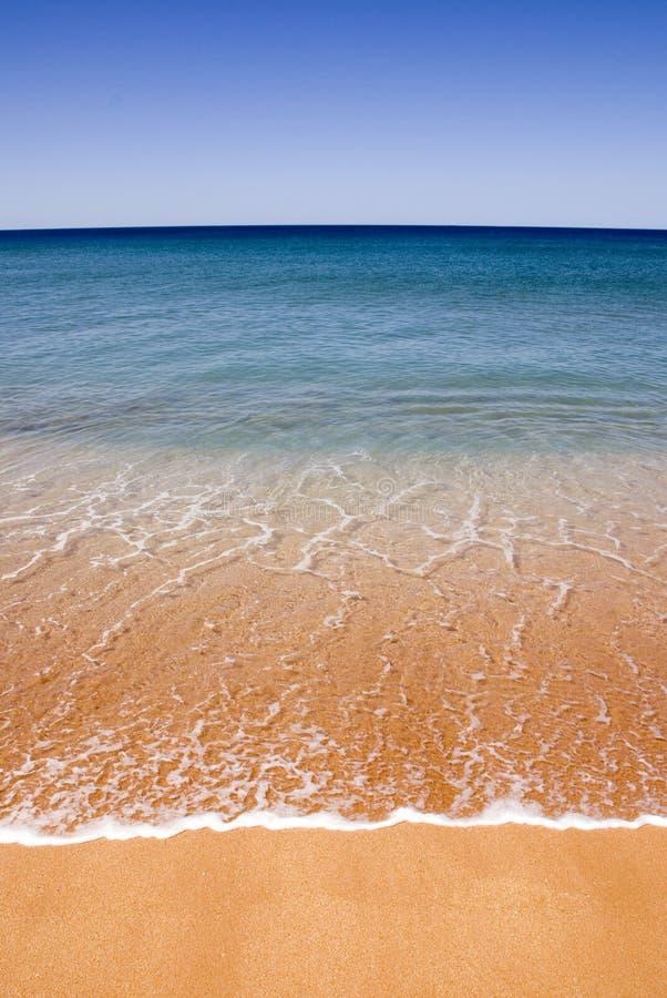 perfekt sand för strandguld arkivfoto
