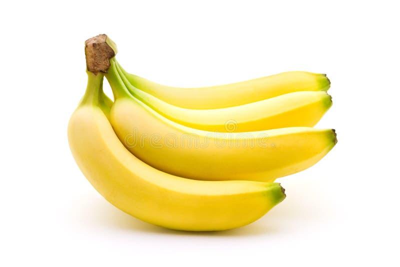 Perfekte Bananen mit gelber und grüner Farbe lokalisiert auf weißem Hintergrund Sportnahrung und -nahrung, Gesundheitswesen und o stockfotografie