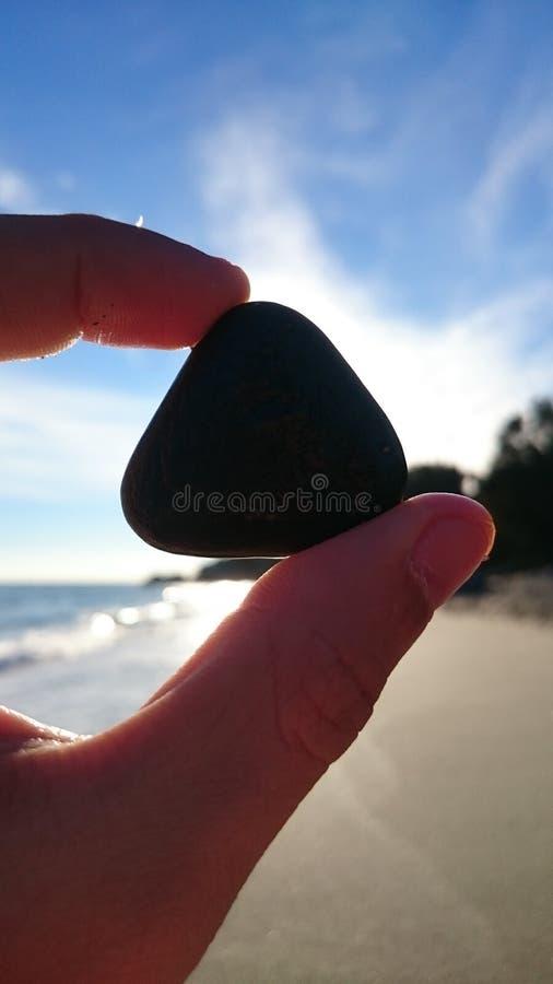Perfekter dreieckiger Felsen stockbild