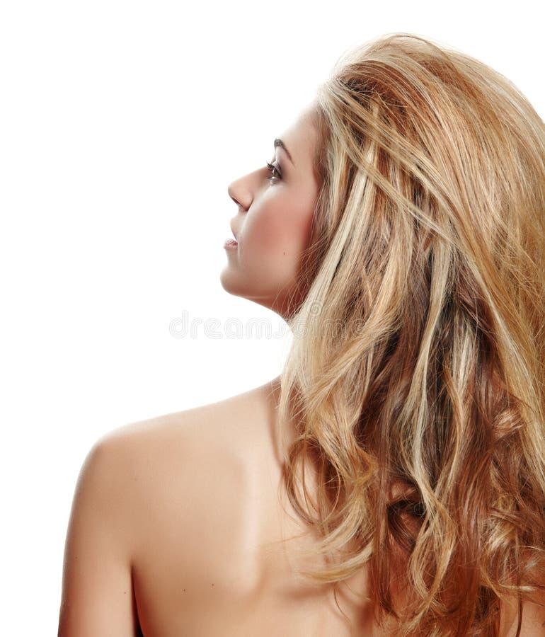 Perfil da mulher loura com cabelo longo foto de stock