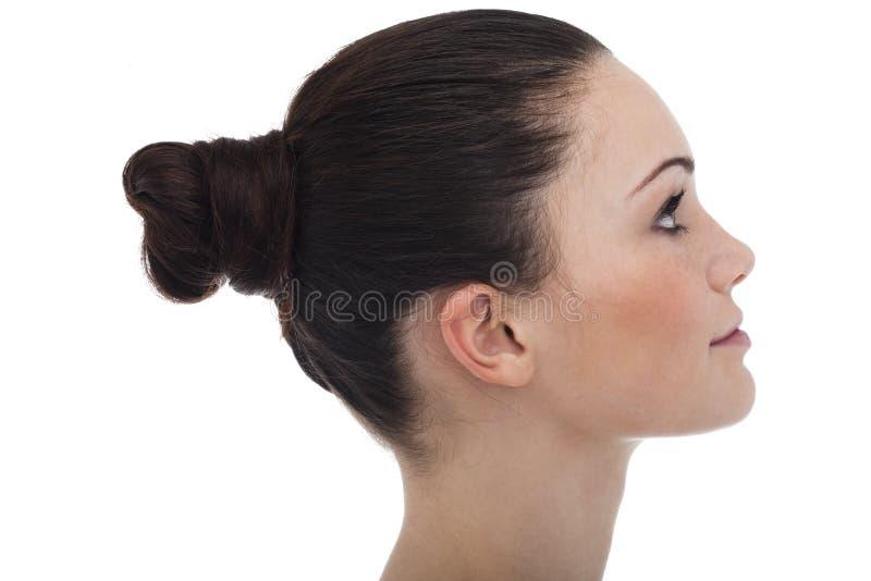 Perfil da mulher nova foto de stock