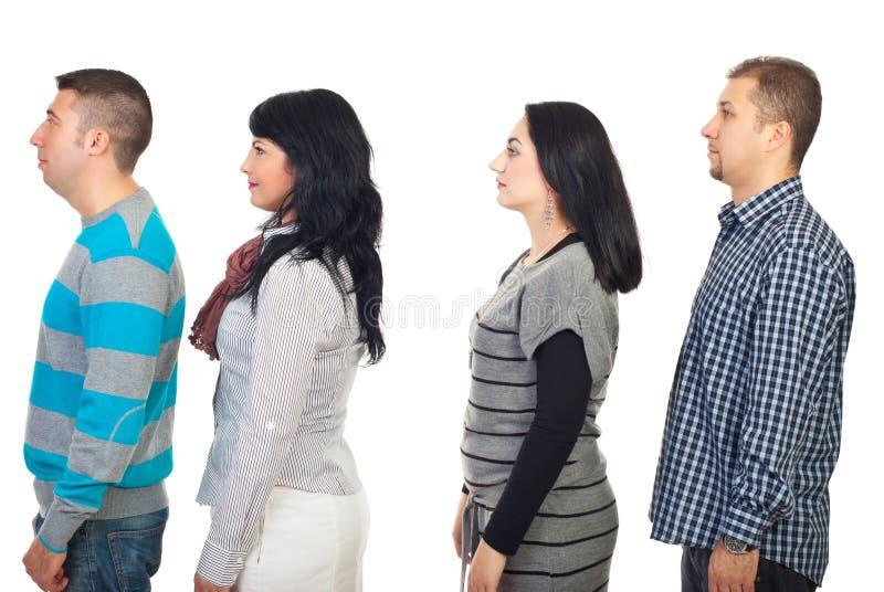 Perfil de cuatro personas fotos de archivo