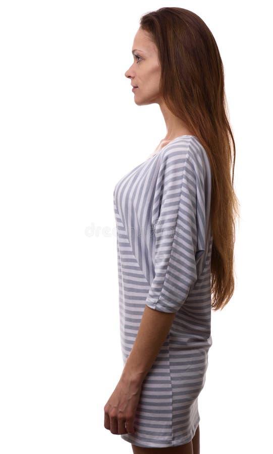 Perfil de la mujer casual confiada que mira adelante foto de archivo libre de regalías