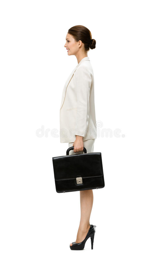 Perfil de la mujer de negocios con la caja negra fotos de archivo
