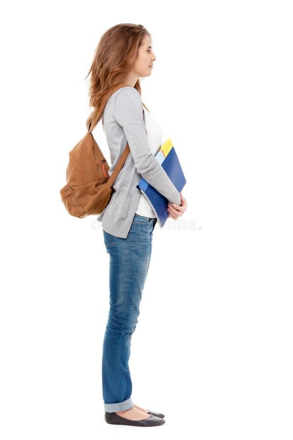Perfil do estudante fêmea feliz isolado no branco imagens de stock