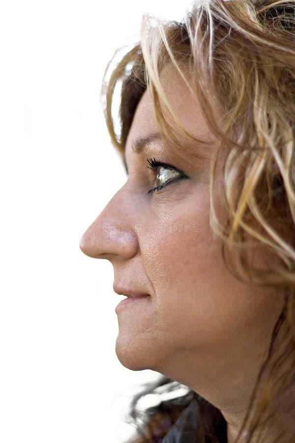 Perfil lateral de una mujer imagen de archivo