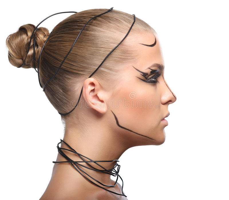 Perfile la cara de la muchacha cibernética hermosa con el maquillaje negro linear i fotos de archivo libres de regalías