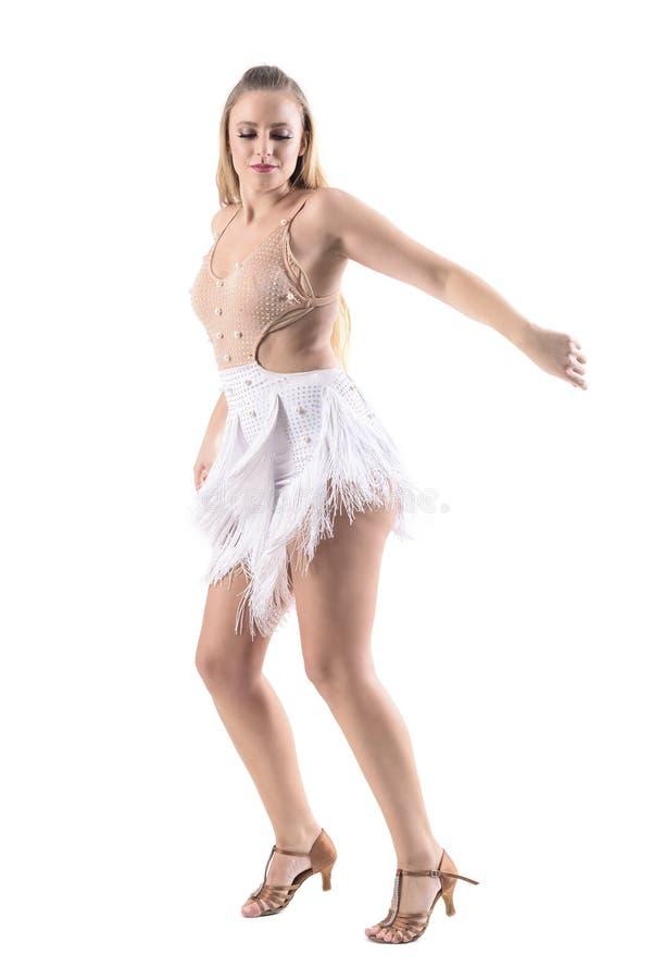 Perfile la opinión el bailarín de sexo femenino experto en la sonrisa profesional del equipo del traje de la danza imagen de archivo