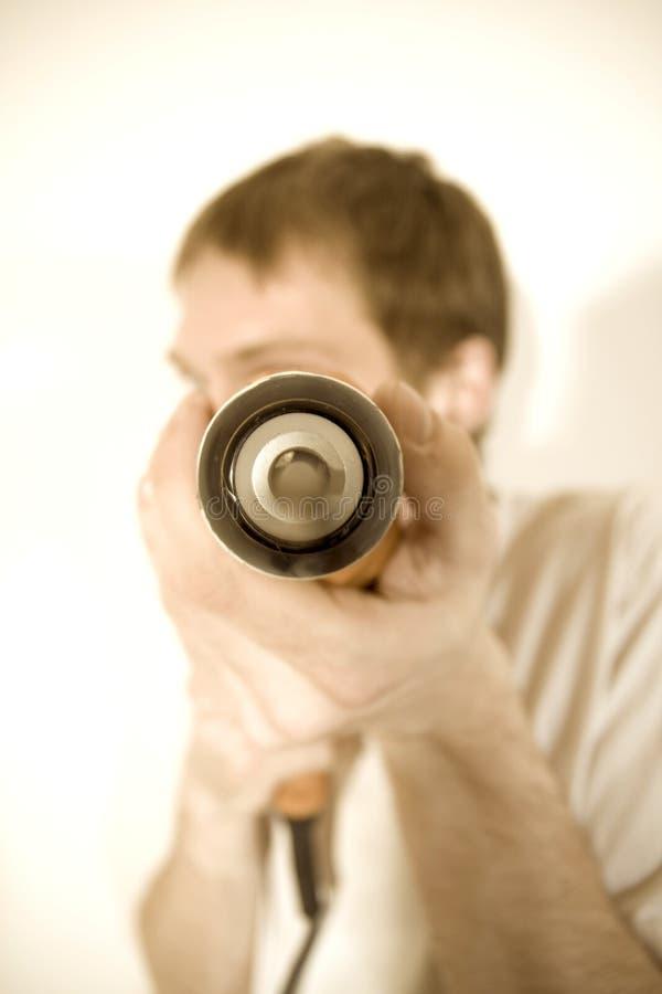 Perforación de un agujero fotos de archivo libres de regalías