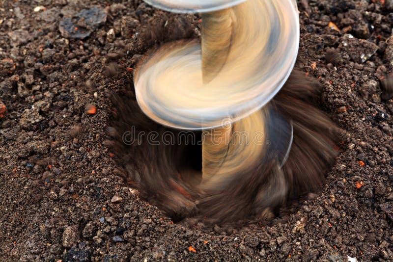 Perforación del taladro de la tierra de taladro de la perforación imagen de archivo