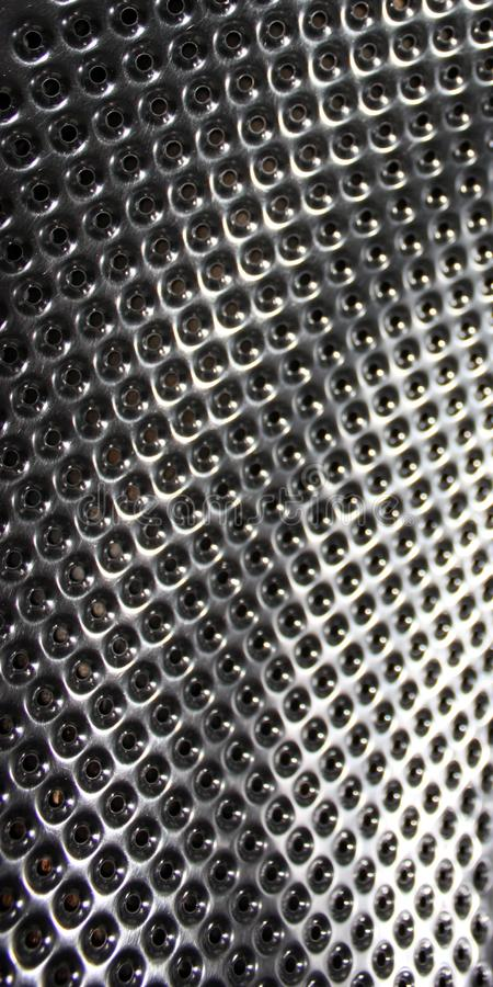 Perforated stainless steel, texture or metallic background stock images