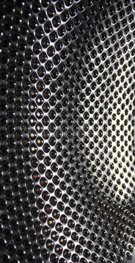 Perforated stainless steel, texture or metallic background stock photo