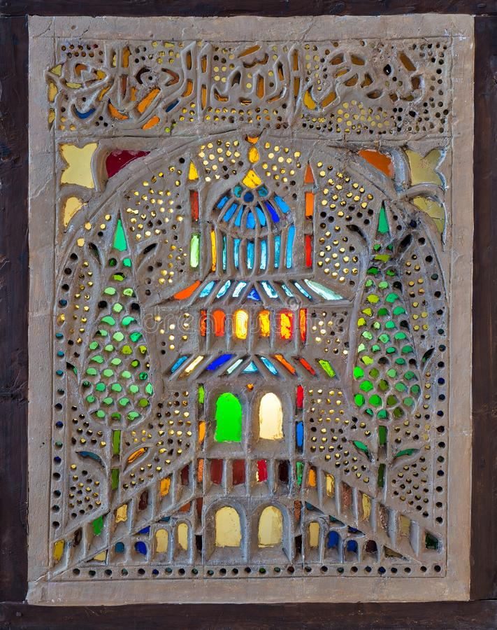 Stucco window decorated with colorful stain glass with floral patterns, a traditions of the Ottoman era. Perforated stucco window decorated with colorful stain stock photos