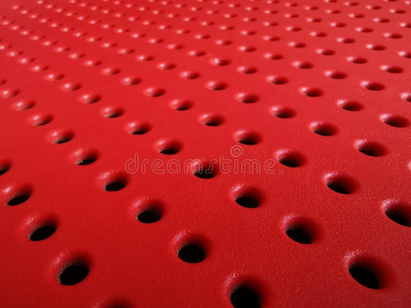 Perforated surface, abstract background, red color. Card for decoration design. Geometric style. Futuristic- digital technology concept. Red background royalty free stock images