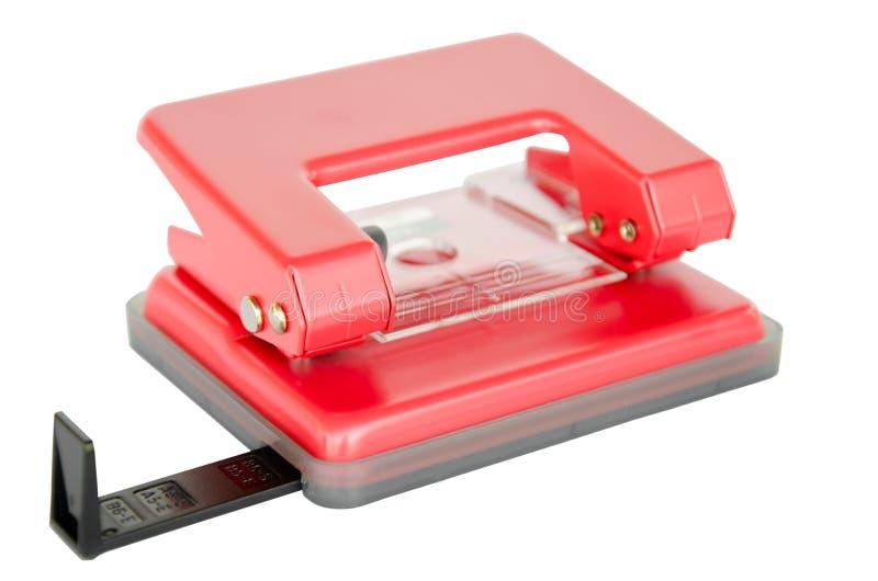 Perforateur de trou de papier de bureau sur le fond blanc photos stock