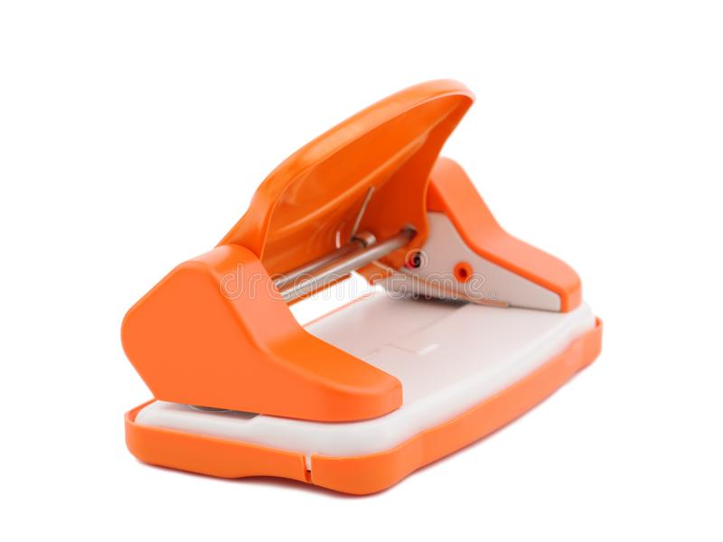 Perforateur de trou orange de papier de bureau, d'isolement sur le blanc images libres de droits