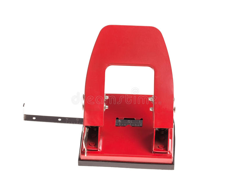 Perforateur de trou rouge de bureau photographie stock libre de droits