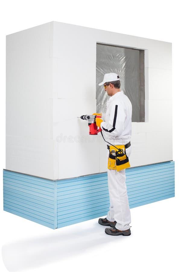 Perforazione Del Lavoratore Con Un Perforatore Immagine Stock