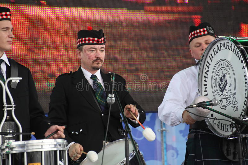 Performance artists, orchestra, ensemble Scottish national musical instruments pipes and drums. At the gala concert dedicated to the opening of the fourth royalty free stock photo