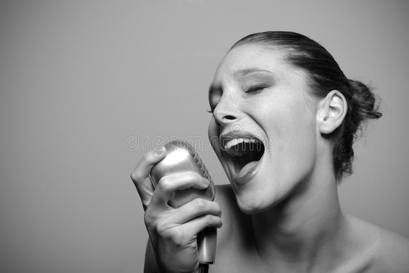 Performance of a beautiful woman singer royalty free stock photos