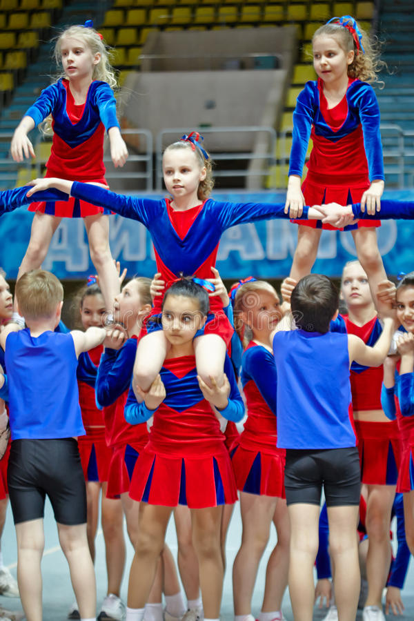 Performance of children cheerleaders team stock photos