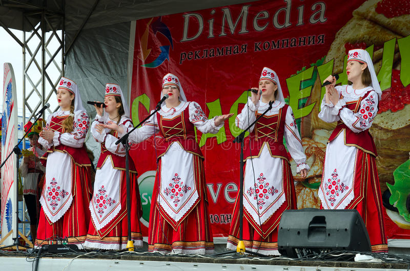 Performance of creative choral collective during Shrovetide fest. GOMEL, BELARUS - MARCH 12, 2016: Performance of creative choral collective. Concert was royalty free stock photo