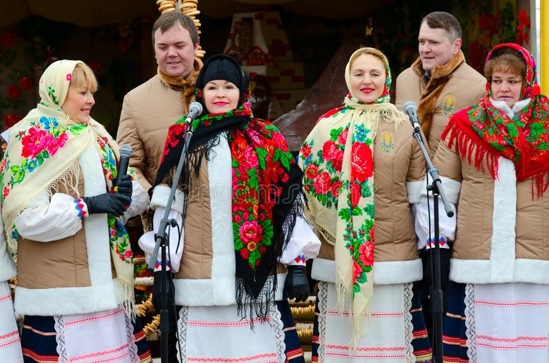 Performance of creative collective during Shrovetide festivities, Gomel, Belarus. GOMEL, BELARUS - FEBRUARY 18, 2018: Performance of creative collective during royalty free stock photography