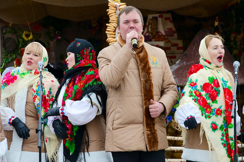 Performance of creative collective during Shrovetide festivities outdoors, Gomel, Belarus. GOMEL, BELARUS - FEBRUARY 18, 2018: Performance of creative collective stock image