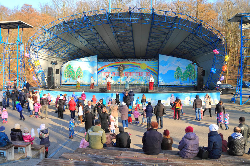 Performance of dancing collective on a scene of the park. KALININGRAD, RUSSIA - MARCH 13, 2016: Performance of dancing collective on a scene of the Central park stock images