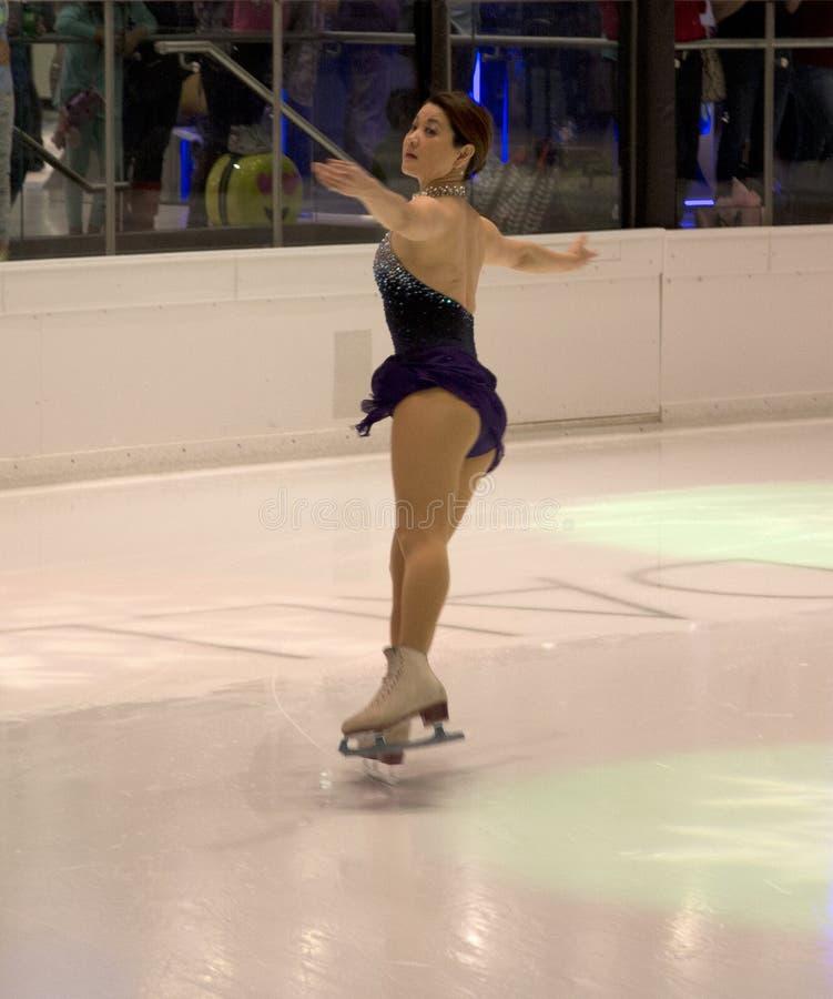 Performance olympique de patinage artistique de YuKa SaTo de champion photos stock
