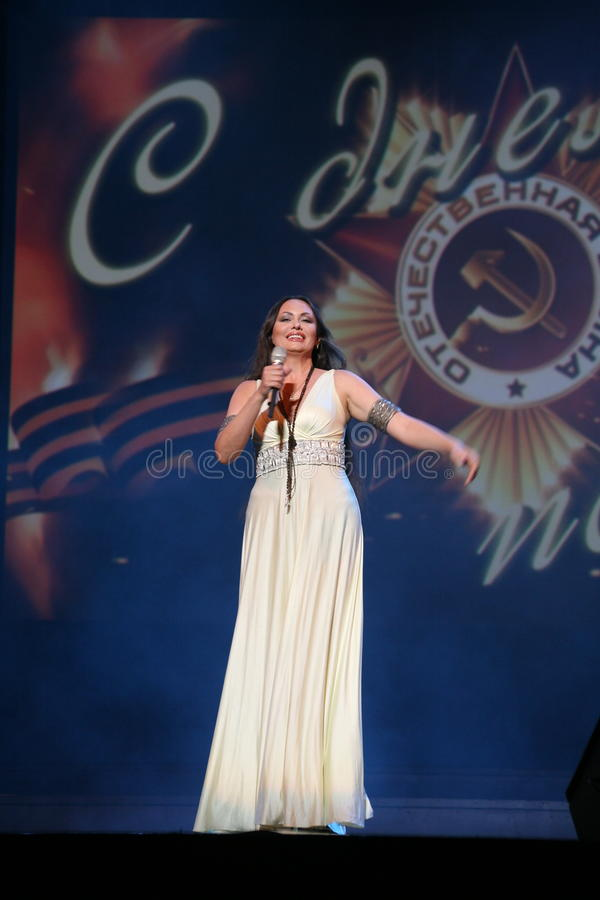 The performance on the stage actress and singer of russian classical crossover diva Larisa Lusta. A charity concert for the disabled and veterans of the second stock images