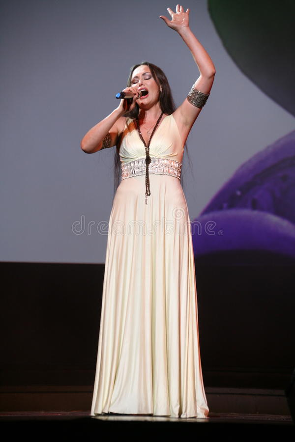 The performance on the stage actress and singer of russian classical crossover diva Larisa Lusta. A charity concert for the disabled and veterans of the second royalty free stock image