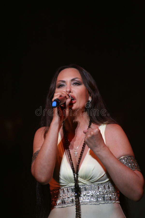 The performance on the stage actress and singer of russian classical crossover diva Larisa Lusta. A charity concert for the disabled and veterans of the second royalty free stock images