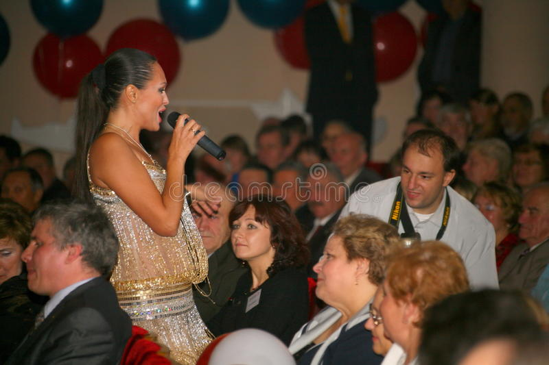 The performance on the stage actress and singer of russian classical crossover diva Larisa Lusta. The performance on the stage of Palace of culture and science stock image