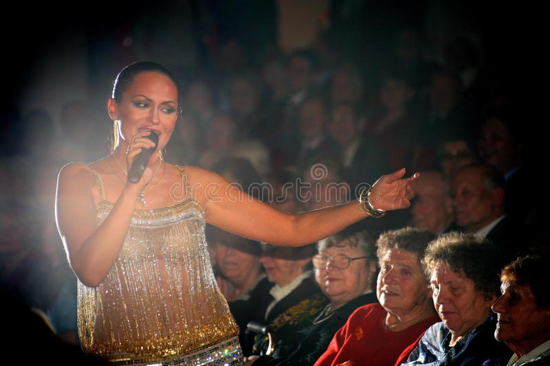 The performance on the stage actress and singer of russian classical crossover diva Larisa Lusta. The performance on the stage of Palace of culture and science stock photo