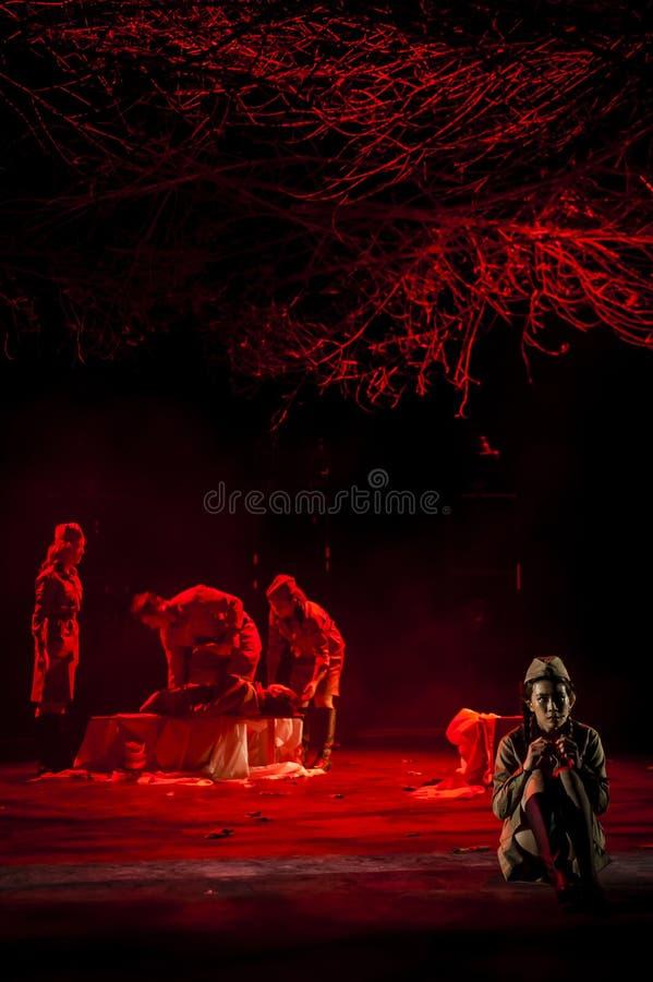 Performance on stage in dark studio stock images